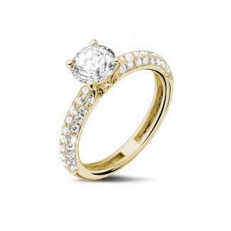 Rings - 1.00 carat solitaire ring (half set) in yellow gold with side diamonds