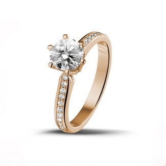 Engagement - 1.00 carat solitaire diamond ring in red gold with side diamonds