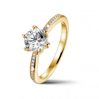 Engagement - BAUNAT Iconic 1.00 carat solitaire ring in yellow gold with side diamonds