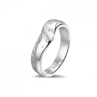 - Diamond design eternity ring in platinum with small diamonds
