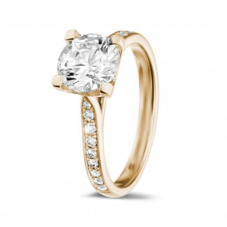 - 1.50 carat solitaire diamond ring in red gold with side diamonds