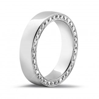 Wedding - 0.70 carat eternity ring in white gold with small round diamonds on the side