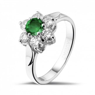 - Flower ring in white gold with a round emerald and side diamonds