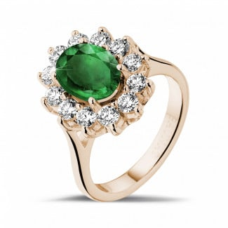 Jewels with ruby, sapphire and emerald - Entourage ring in red gold with an oval emerald and round diamonds