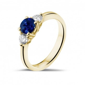 Engagement - Trilogy ring in yellow gold with a central sapphire and 2 round diamonds