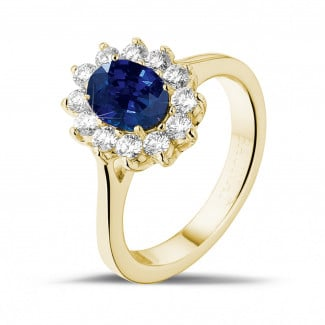 Jewels with ruby, sapphire and emerald - Entourage ring in yellow gold with an oval sapphire and round diamonds