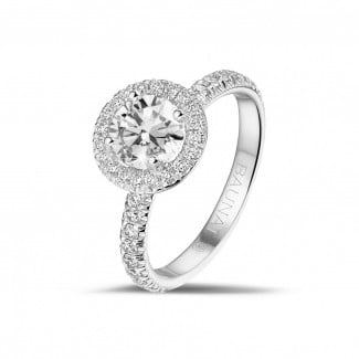 - 1.00 carat solitaire halo ring in white gold with round diamonds