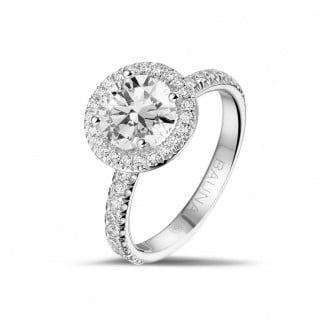 - 1.50 carat solitaire halo ring in platinum with round diamonds