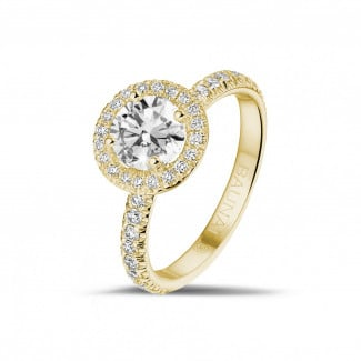 Romantic - 1.00 carat solitaire halo ring in yellow gold with round diamonds