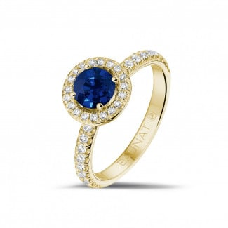 Engagement - Halo solitaire ring in yellow gold with a round sapphire and small diamonds