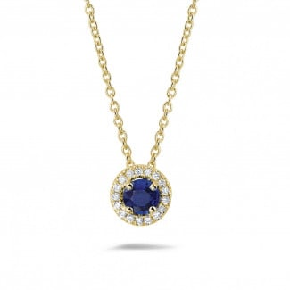 Yellow Gold Diamond Necklaces - Halo necklace in yellow gold with a central sapphire and round diamonds