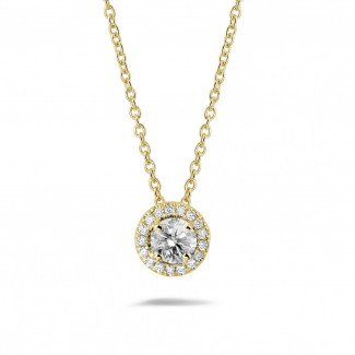 - 0.50 carat diamond halo necklace in yellow gold