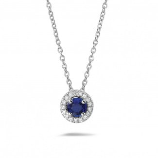 Diamond Pendants - Halo necklace in white gold with a central sapphire and round diamonds