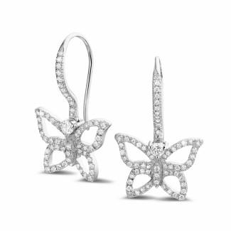 - 0.70 carat diamond butterfly designed earrings in platinum