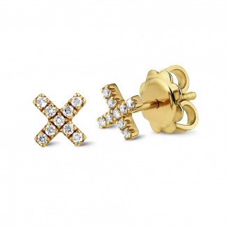 Originality - XX earrings in yellow gold with small round diamonds