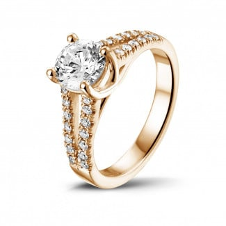 Classics - 1.00 carat solitaire ring in red gold with side diamonds