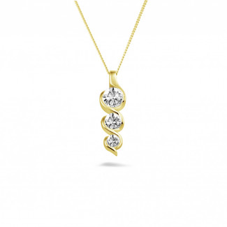 Necklaces - 0.85 carat trilogy diamond pendant in yellow gold
