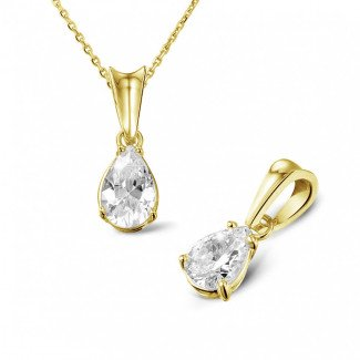 0.75 carat yellow golden solitaire pendant with pear shaped diamond