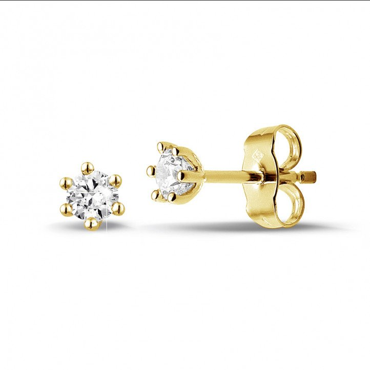 0.30 carat classic diamond earrings in yellow gold with six prongs