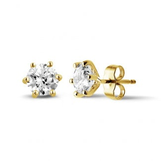 2.00 carat classic diamond earrings in yellow gold with six prongs