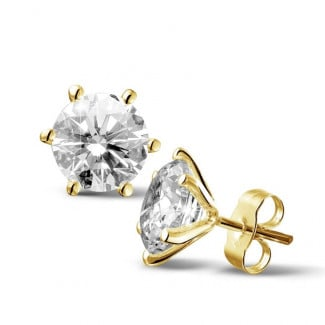 4.00 carat classic diamond earrings in yellow gold with six prongs