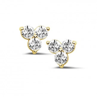 - 1.20 carat diamond trilogy earrings in yellow gold