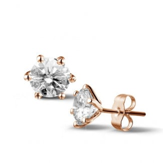 2.50 carat classic diamond earrings in red gold with six prongs