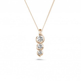 - 0.57 carat trilogy diamond pendant in red gold