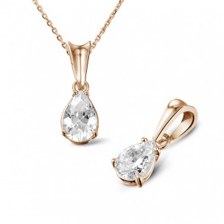 0.75 carat red golden solitaire pendant with pear shaped diamond