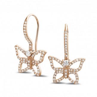 - 0.70 carat diamond butterfly designed earrings in red gold
