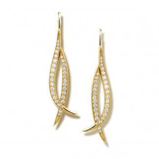 Nathu collection - 0.76 carat diamond design earrings in yellow gold