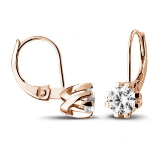 - 1.00 carat diamond design earrings in red gold with eight prongs
