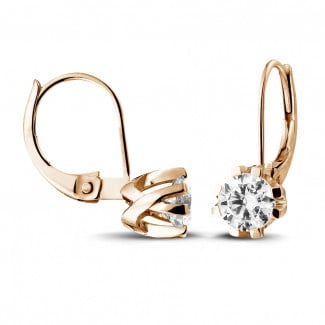 1.80 carat diamond design earrings in red gold with eight prongs