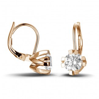 2.20 carat diamond design earrings in red gold with eight prongs