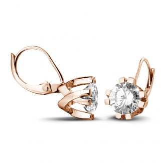 2.50 carat diamond design earrings in red gold with eight prongs