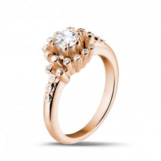- 0.50 carat diamond design ring in red gold