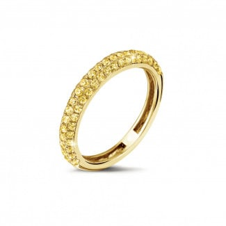 0.65 carat eternity ring (half set) in yellow gold with yellow diamonds