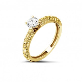Rings - 0.50 carat solitaire ring (half set) in yellow gold with yellow side diamonds