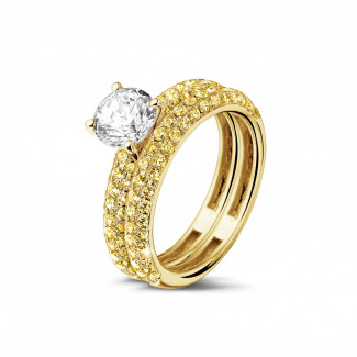 Yellow Gold Diamond Engagement Rings - Matching engagement and wedding band in yellow gold with a central diamond of 1.00 carat and small yellow diamonds