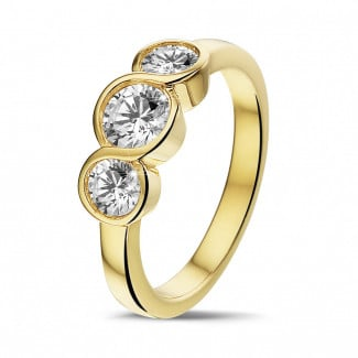 Classics - 0.95 carat trilogy ring in yellow gold with round diamonds