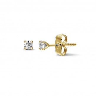 - 0.30 carat classic diamond earrings in yellow gold with four prongs