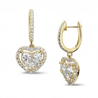 Romantic - 1.35 carat heart-shaped earrings in yellow gold with round diamonds