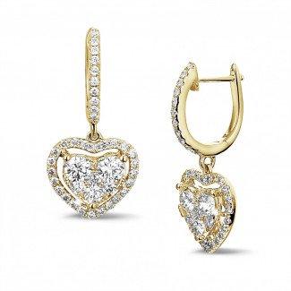 Yellow Gold Diamond Earrings - 1.35 carat heart-shaped earrings in yellow gold with round diamonds