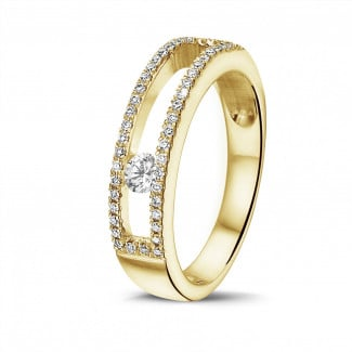 Classics - 0.25 carat ring in yellow gold with a floating round diamond