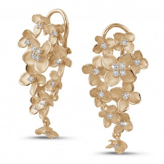 - 0.70 carat diamond design floral earrings in red gold