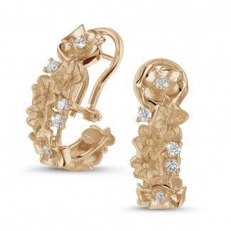 - 0.50 carat diamond design floral earrings in red gold