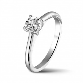 Engagement - 0.50 carat solitaire ring in platinum with round diamond and four prongs