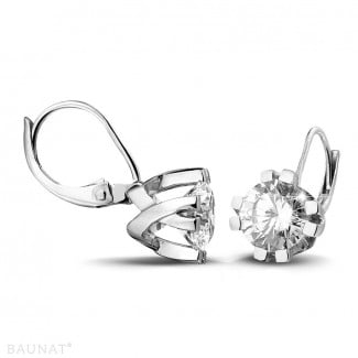 - 2.20 carat diamond design earrings in white gold with eight prongs