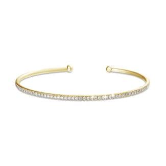 Bracelets - 0.75 carat diamond bangle in yellow gold