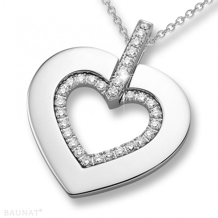 0.36 carat heart shaped white golden pendant with small round diamonds